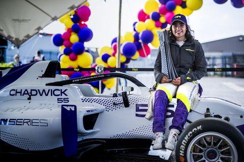 jamie chadwick sits atop her w series car triumphant