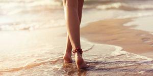 walking on beach barefoot during sunset