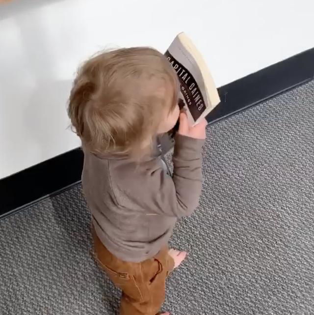 crew kissing a book