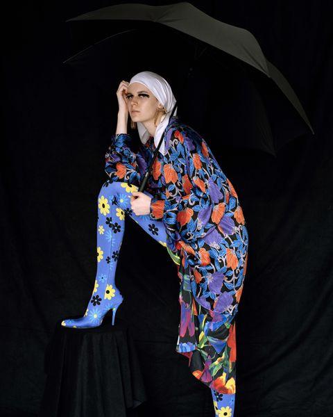 Sleeve, Umbrella, Electric blue, Street fashion, Costume design, Fashion design, Costume, High heels, Hood, Sandal,
