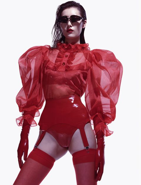 Latex clothing, Red, Clothing, Latex, Outerwear, Muscle, Costume, Thigh, Fictional character, Personal protective equipment,