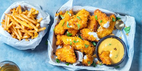 crispy baked cod fish nuggets with crisps on side