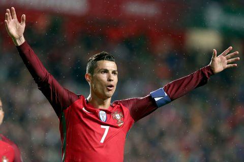 Football player, Soccer player, Player, Team sport, Sports equipment, Gesture, Sports, Fan, Ball game, Football,
