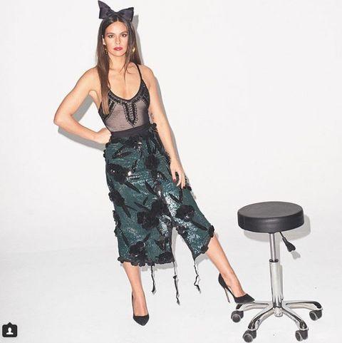 Clothing, Dress, Fashion, Leg, Bar stool, Photo shoot, Costume, Muscle, Furniture, Stool,