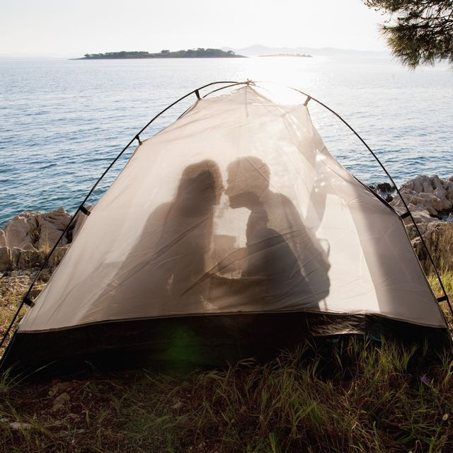 Croatia, Zadar, Young couple kissing in tent at beach