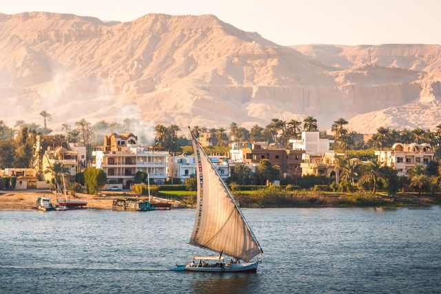 felucca boat is sailing along the nile river in aswan the southern city of egypt
