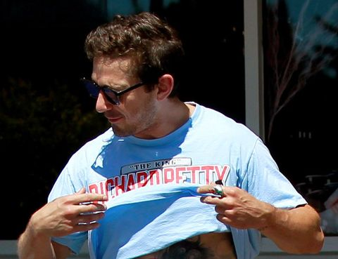 Shia LaBeouf proudly show off his new tattoo and his well built abs to his friend after their lunch date in Beverly Hills.