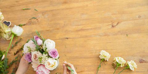 Crop hands of florist making bouquet