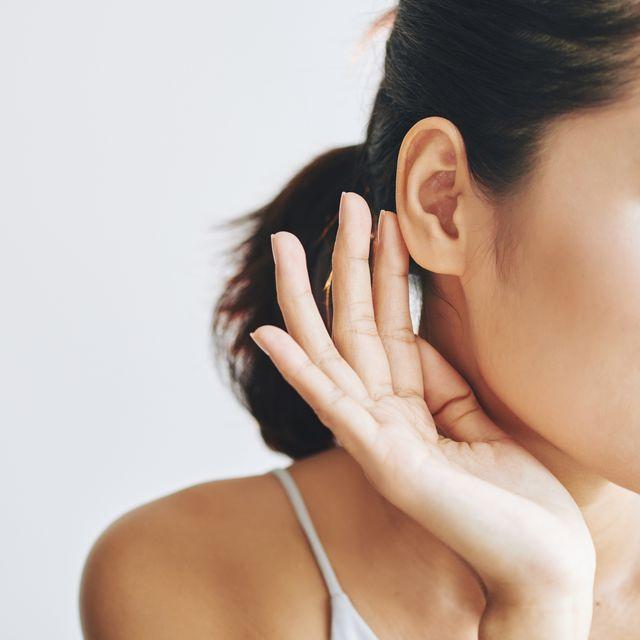 woman touching ear ringing