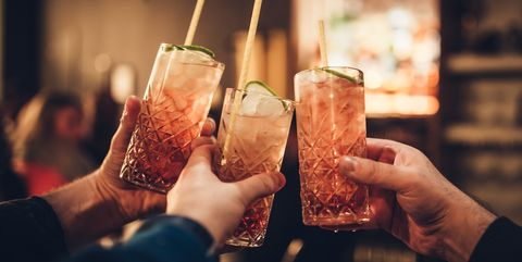 cropped hands of people holding drinks