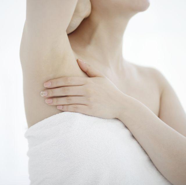 cropped image of woman touching armpit