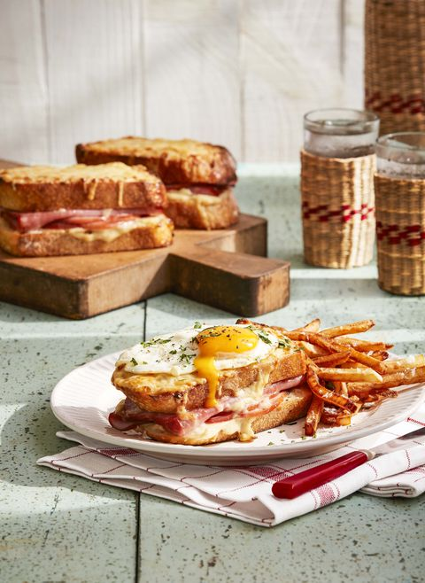 croque madame sandwich on plate with fries