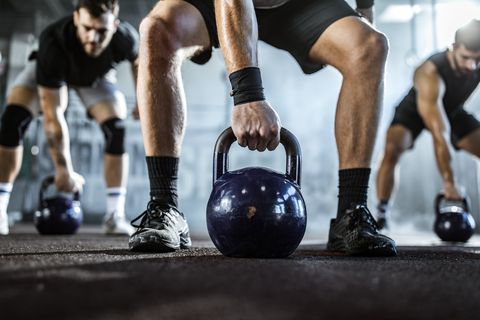 Cross fit with kettle bells in a gym!