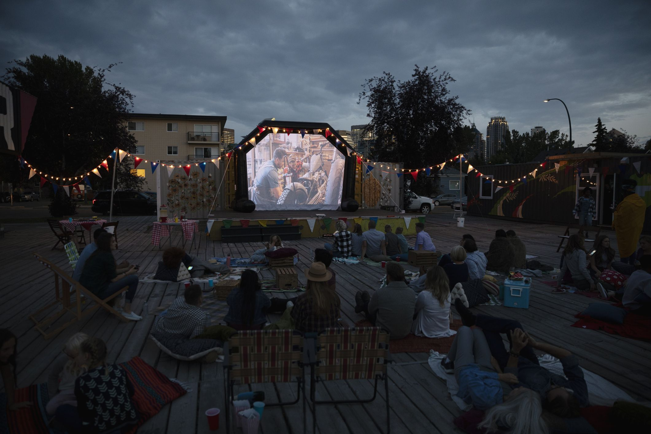 Crowd watching movie in the park