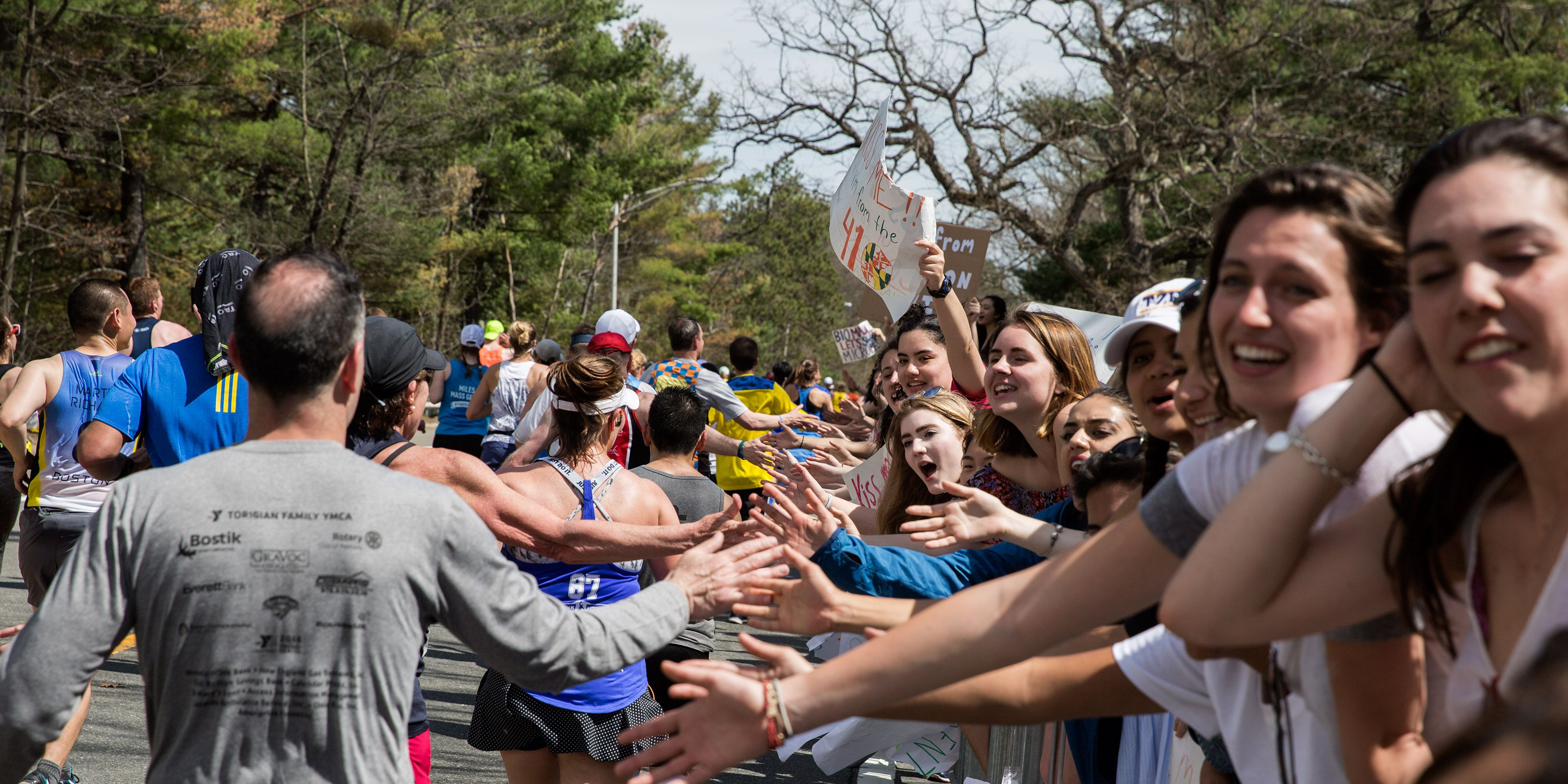 Crowds Gather Along Route of Boston Marathon To Cheer On Runners