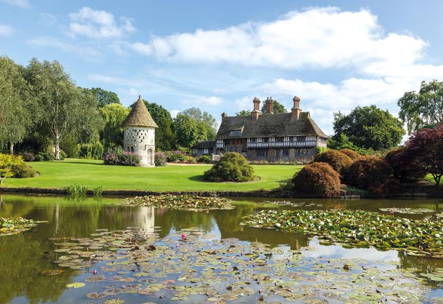 a moated manor house in rural surrey