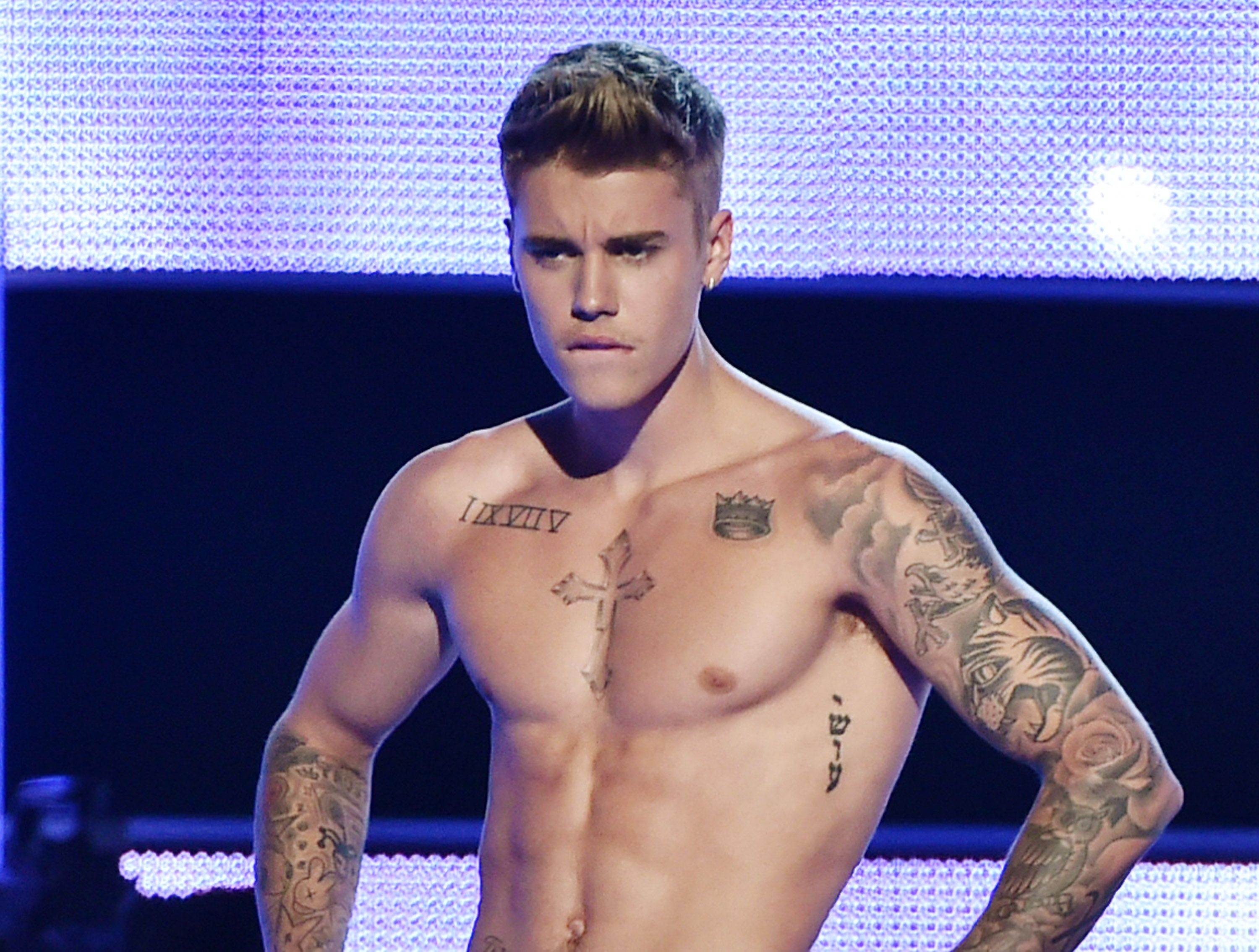 ad59d5fab Justin Bieber's Tattoos - The Meaning Behind Justin Bieber's Tattoos