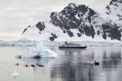 Sea kayaks, cruise ship MV Sea Spirit and iceberg
