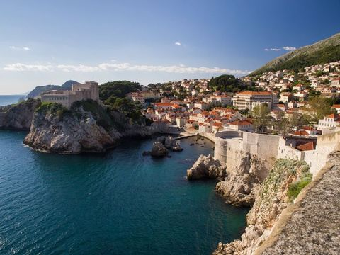 Body of water, Coast, Sea, Promontory, Coastal and oceanic landforms, Town, Cliff, Bay, Headland, Sky,