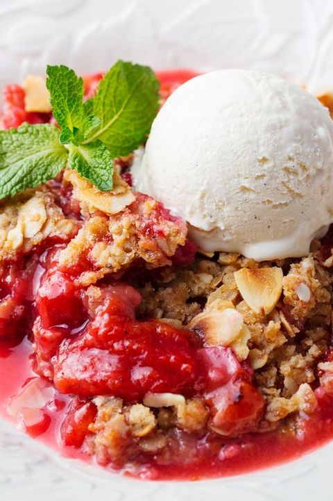 Crumble with berries and fruits with vanilla ice cream.