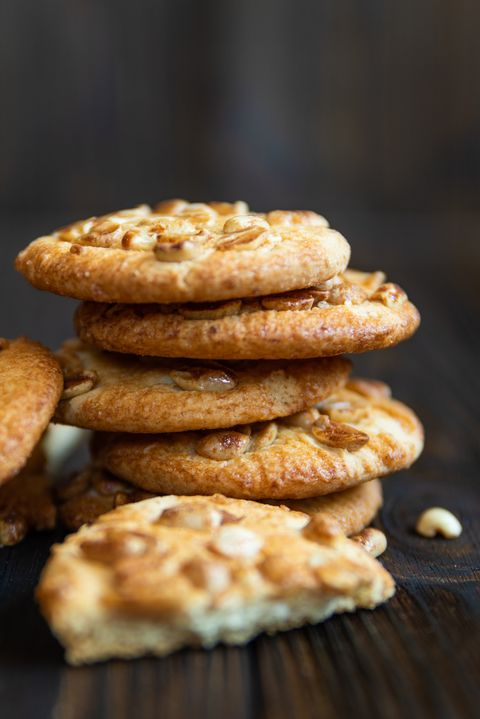 crunchy cookies with peanuts on wooden table