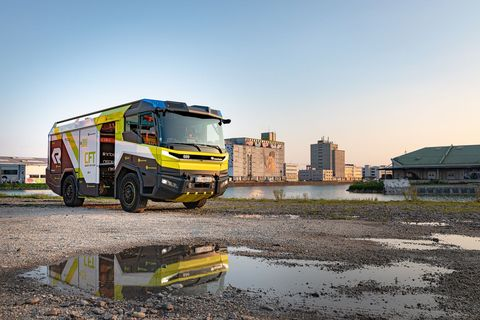 Transport, Vehicle, Mode of transport, Yellow, Car, Commercial vehicle, Wheel, Truck, Automotive wheel system, Asphalt,