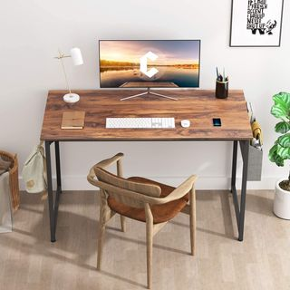 home office area with walnut desk with computer and lamp