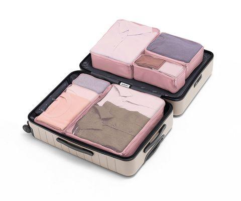 Cubos de organización para el equipaje en color rosa