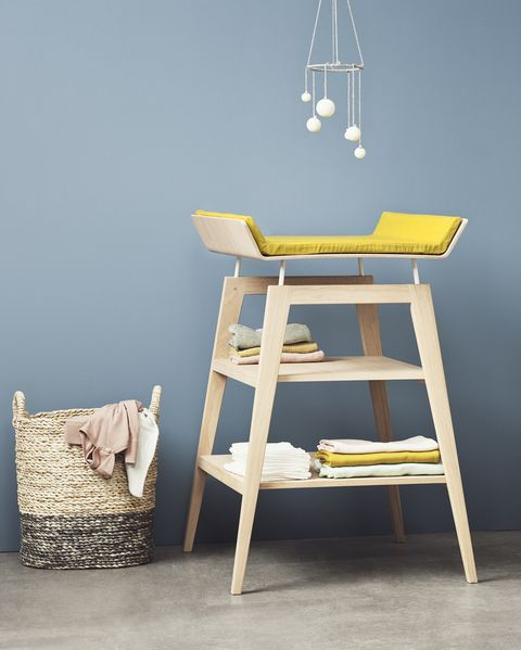 Yellow and wooden changing table