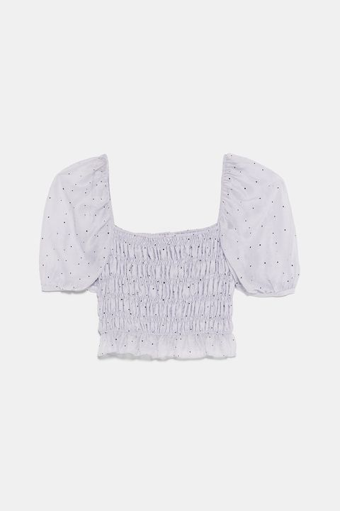 White, Clothing, Arm, Crop top, Blouse, Outerwear, Sleeve, Font, Beige, Neck,