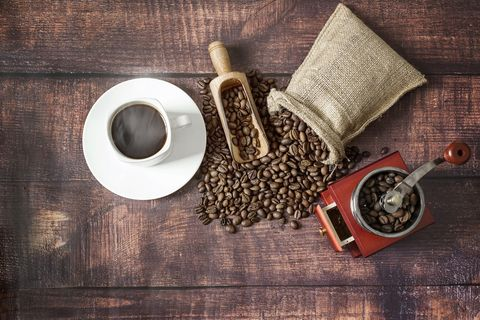 cup of coffee with coffee beans roasted