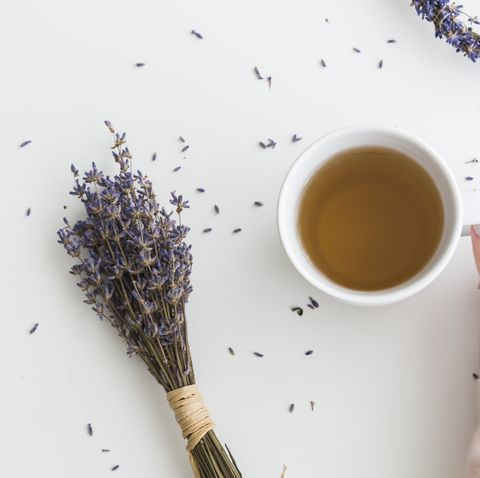 cup of herbal lavender tea with dried flowers