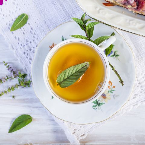 cup of tea with peppermint on  lacy napkin