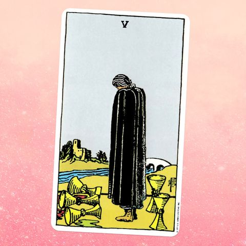 The Five Cups tarot card, showing a masked figure standing on a riverbank looking out into the water, with five cups spilled around them