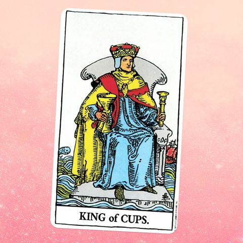 the tarot card the king of cups, showing a person in a robe, cape, and crown sitting on a throne, holding a golden goblet in one hand and a sceptre in the other