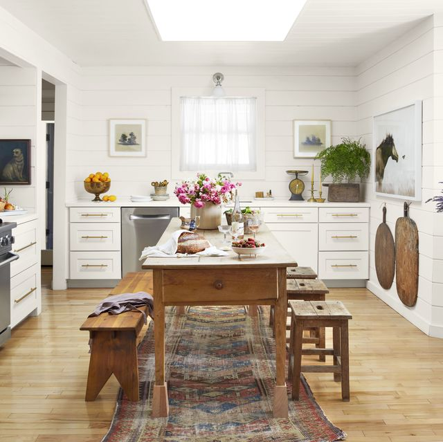 white farmhouse kitchen with shiplap and pine table and benches