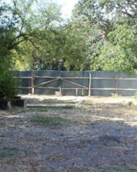 dirt covered backyard before redo