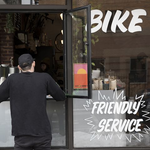 Customer at service window, Nike and Coffee shop, New York, USA