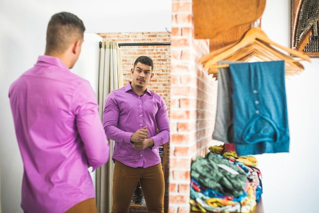 customer tasting clothes in men's clothing
