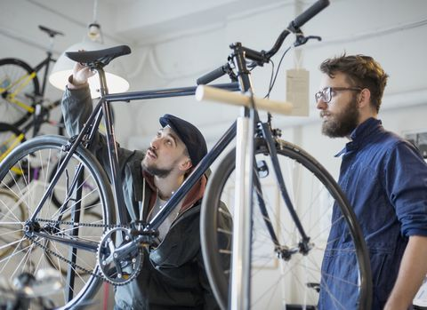customer with salesperson looking at bicycle in bike shop