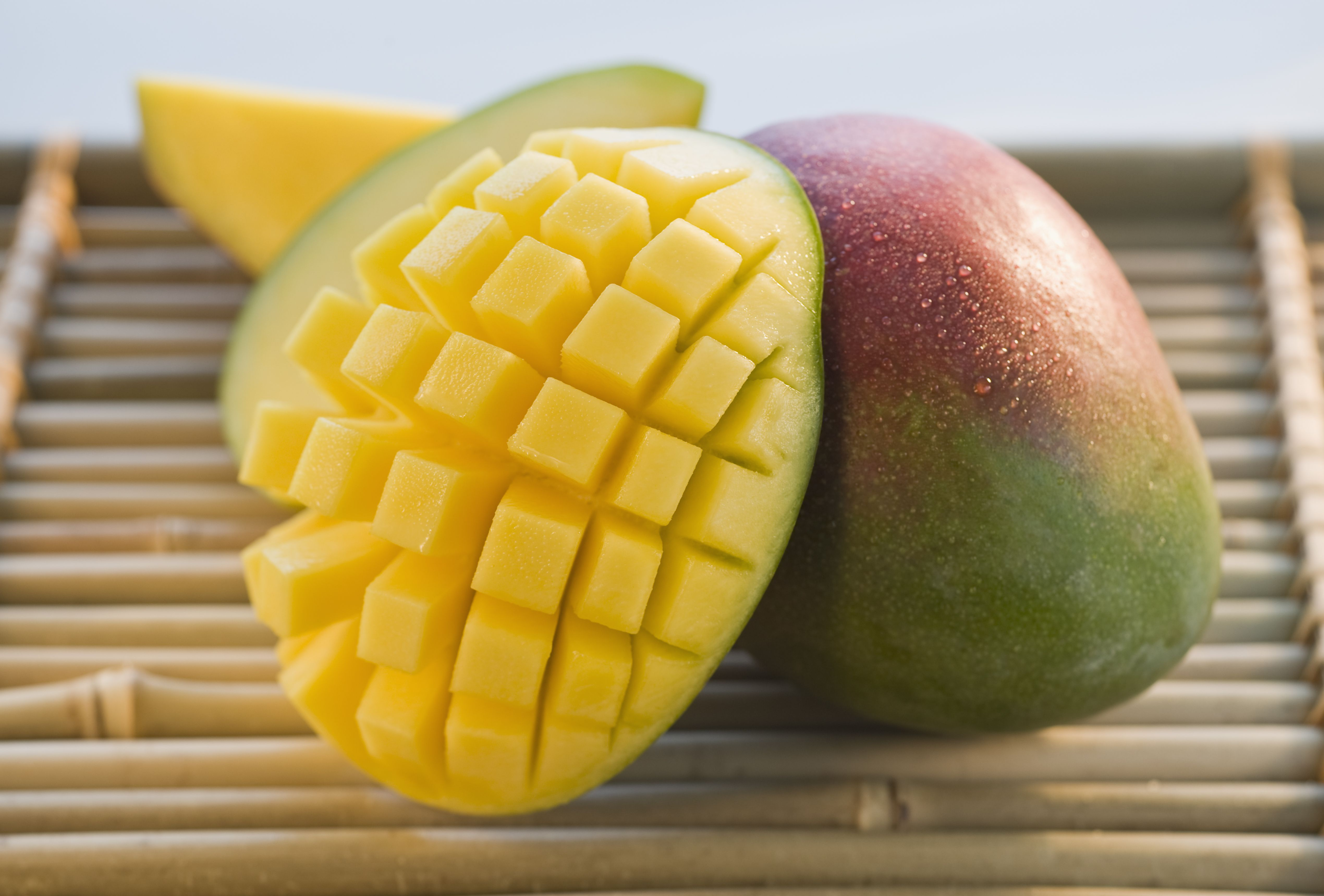 cut mango on bamboo tray high res stock photography sb y 001