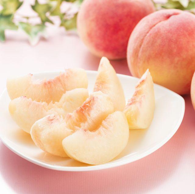 cut peach on a dish