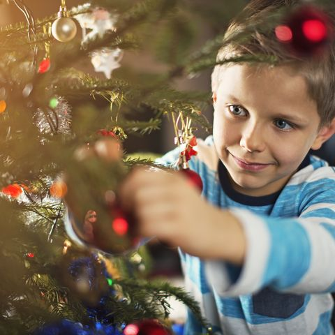 cute little boy decorating christmas tree - Images For Christmas
