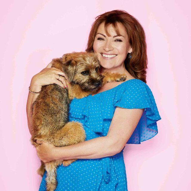 tv presenter lorraine kelly with her border terrier dog angus