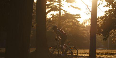 cyclist alone at dawn