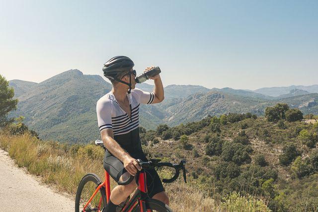 Cyclist drinking from bidon at summit