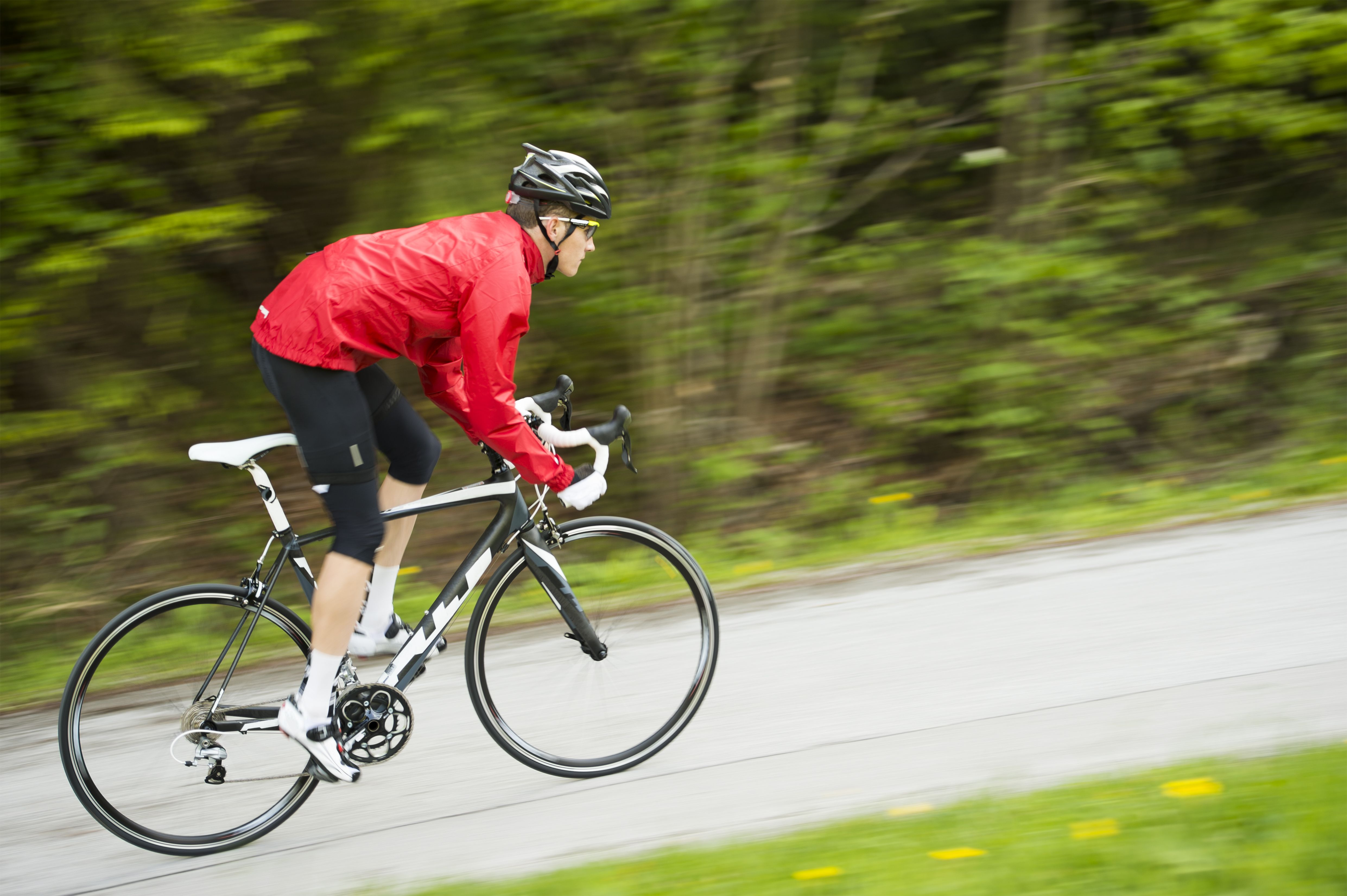 Cyclist in red shirt practicing