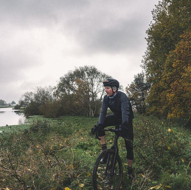 cyclist on river bank