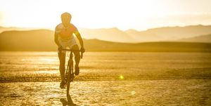 Cyclist riding across desert, Las Vegas, Nevada, USA