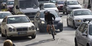 Cyclists and cars in traffic, Leipziger Strasse, Berlin, Germany